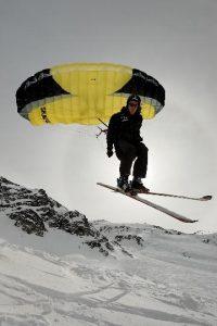 Parapente y esquí nieve